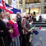 Family singing Advance Australia Fair
